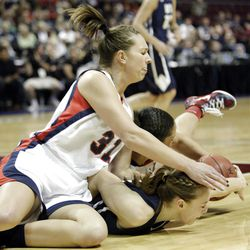 Brigham Young Cougars guard Lexi Eaton (21) and Gonzaga Bulldogs forward Shannon Reader (31) fight for the ball  in the West Coast Conference finals in Las Vegas  Monday, March 5, 2012.  BYU won the title and will advance to the NCAA tournament.