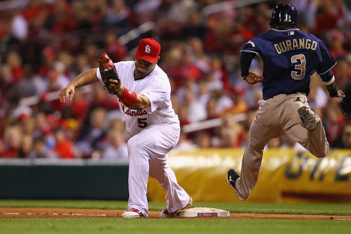 ST. LOUIS - SEPTEMBER 16: Albert Pujols #5 of the St. Louis Cardinals beats Luis Durango #3 of the San Diego Padres to first base for an out at Busch Stadium on September 16 2010 in St. Louis Missouri.  (Photo by Dilip Vishwanat/Getty Images)