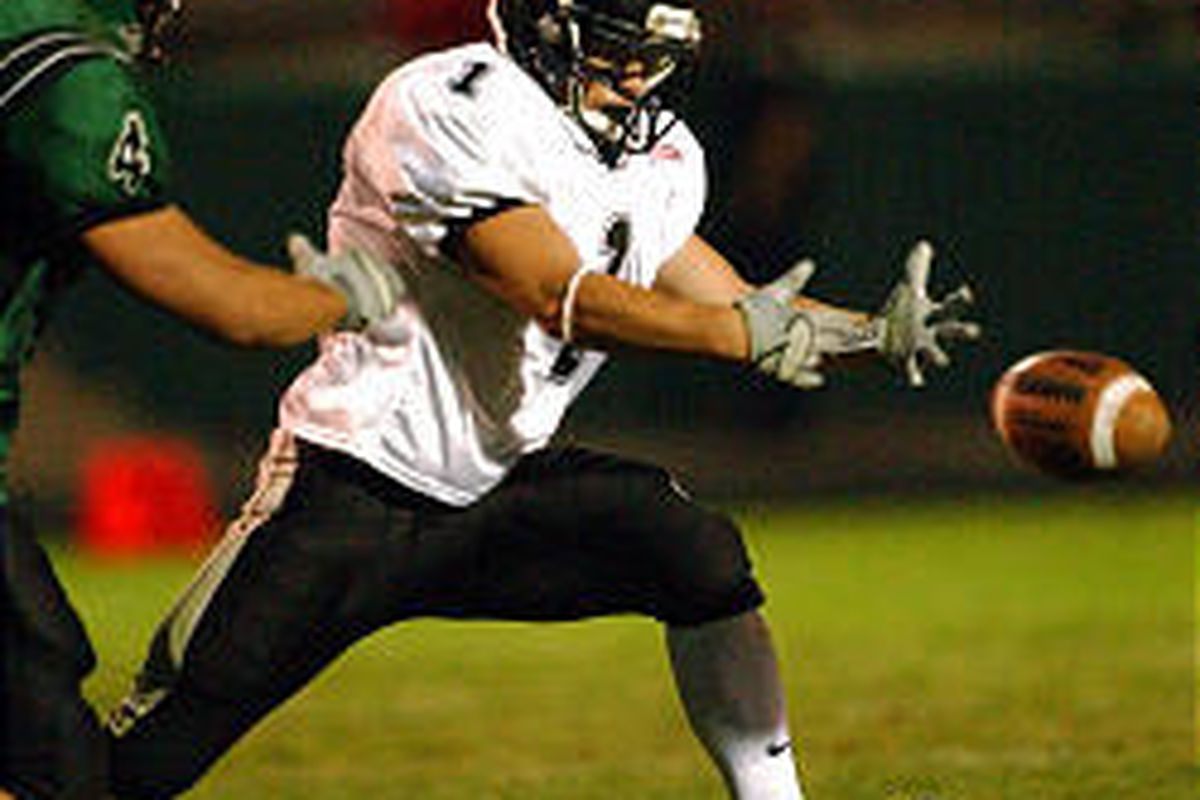 Alta's Broderick Owen tries to pull in a fumbled pitch from the quarterback as Hillcrest's Robert Takeno approaches.