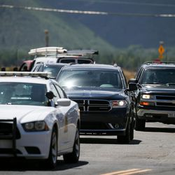 Former President Bill Clinton's motorcade arrives for a fundraiser for his wife, Democratic presidential nominee Hillary Clinton, in the Glenwild community of Park City on Thursday, Aug. 11, 2016.