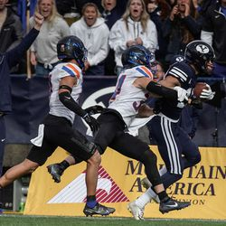 BYU wide receiver Gunner Romney runs past Boise State 's Alexander Teubner, front, and Kaonohi Kaniho after a long reception during an NCAA college football game at LaVell Edwards Stadium in Provo on Saturday, Oct. 9, 2021.