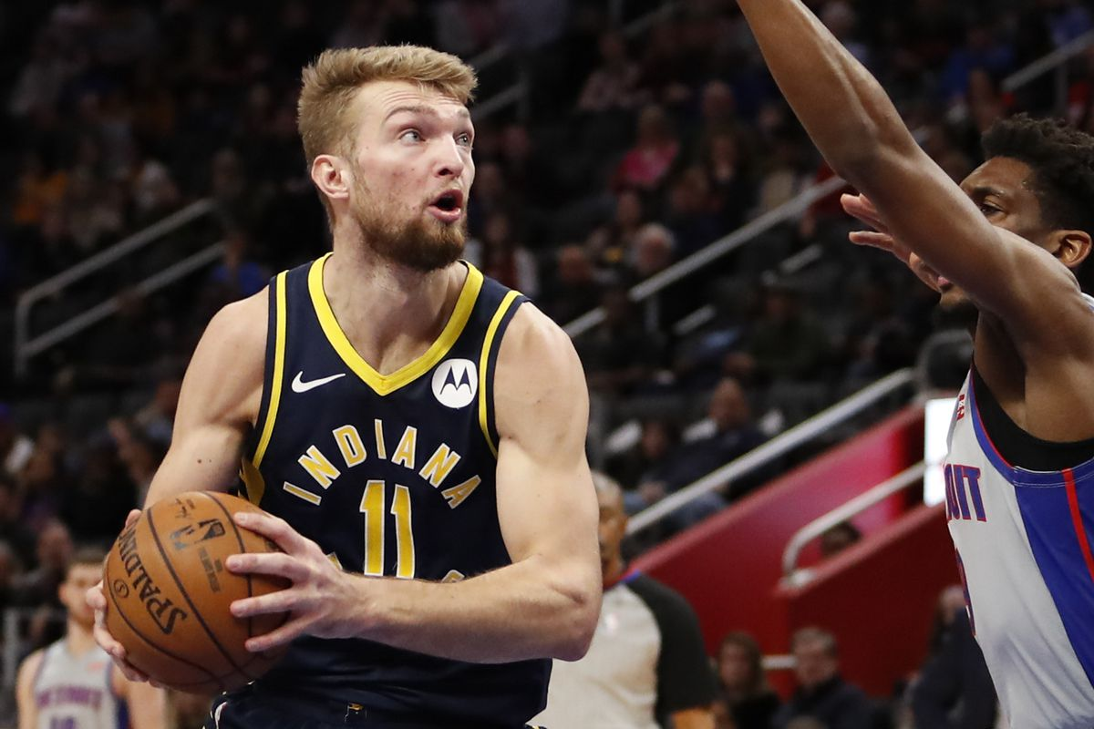 Indiana Pacers forward Domantas Sabonis gets defended by Detroit Pistons guard Langston Galloway during the first quarter at Little Caesars Arena.