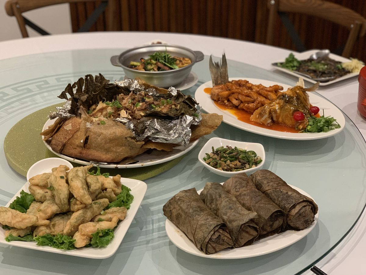 Array of regional Chinese dishes on a lazy susan in an LA Chinese restaurant.