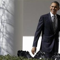 President Barack Obama looks towards reporters shouting questions as he walks down the West Wing Colonnade of the White House in Washington, Tuesday, Feb. 12, 2013, ahead of tonight's State of the Union speech on Capitol Hill.