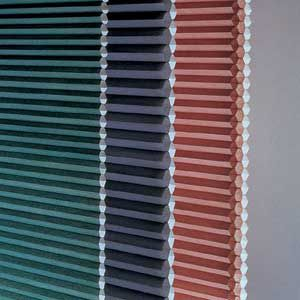 <p>Cross-sections of single-, double- and triple-honeycomb shades show the structure of their insulating channels.</p>