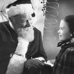 """Edmund Gwenn is Kris Kringle, trying to convince a little girl (Natalie Wood) that he's for real in """"Miracle on 34th Street"""" (1947)."""