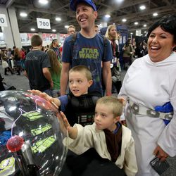 Harper Brace, as Darth Vader, and Collier Brace, as Yoda, attend Comic Con with their parents, Matt Brace and Heather Brace, at the Salt Palace Convention Center in Salt Lake City on Saturday, Sept. 7, 2013.