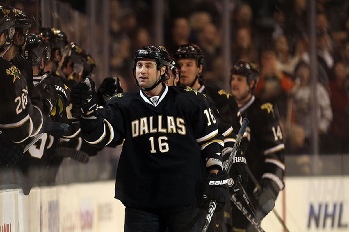 DALLAS TX - JANUARY 15:  Adam Burish #16 of the Dallas Stars celebrates a goal against the Atlanta Thrashers at American Airlines Center on January 15 2011 in Dallas Texas.  (Photo by Ronald Martinez/Getty Images)