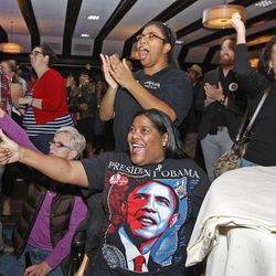 Meta Hutchison and Utah Democrats celebrate as President Barack Obama passes the needed electoral votes to win re-election as Utah Democrats gather at the Salt Lake Sheraton on election night Tuesday, Nov. 6, 2012, in Salt Lake City, Utah.