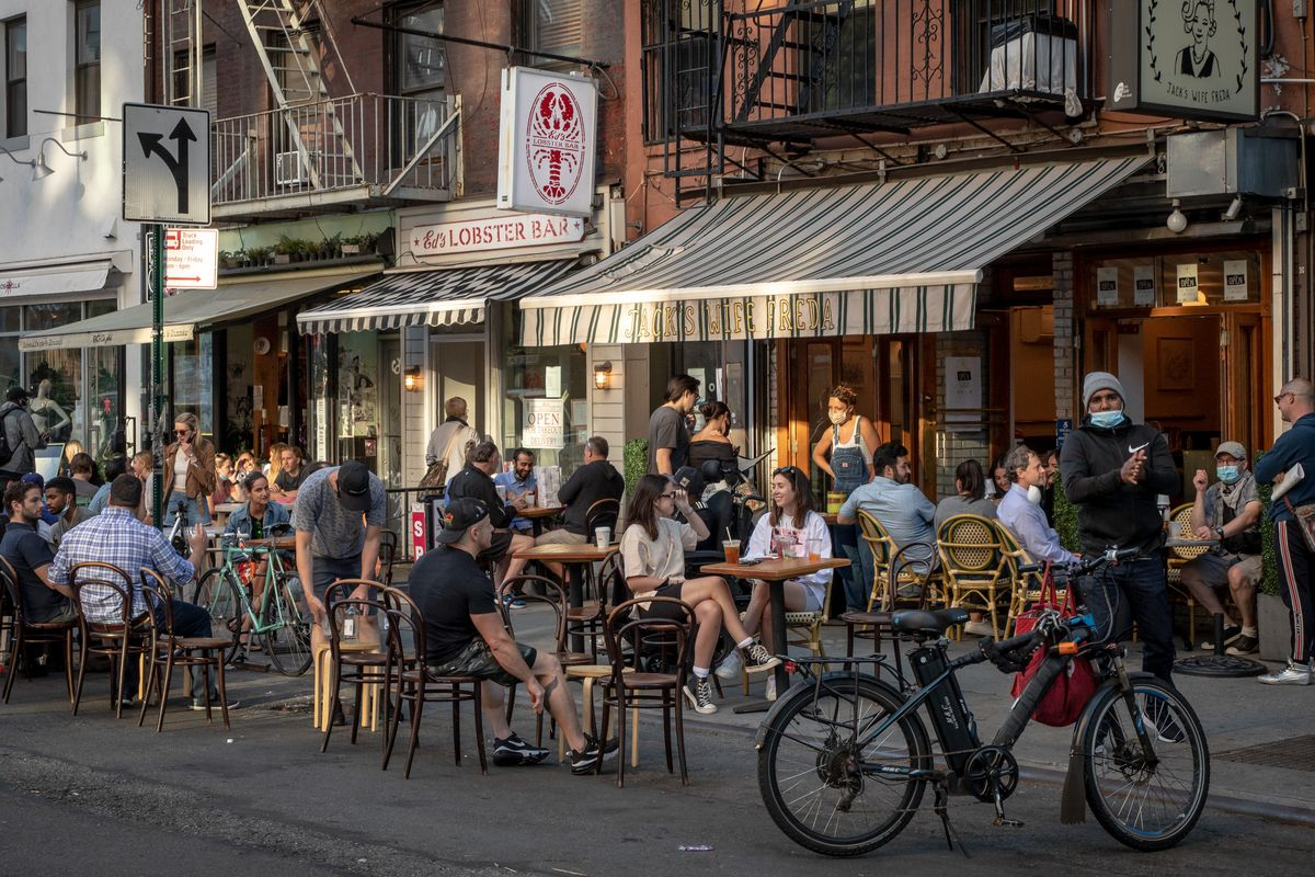 Tables and chairs are set outside restaurants on Lafayette St.