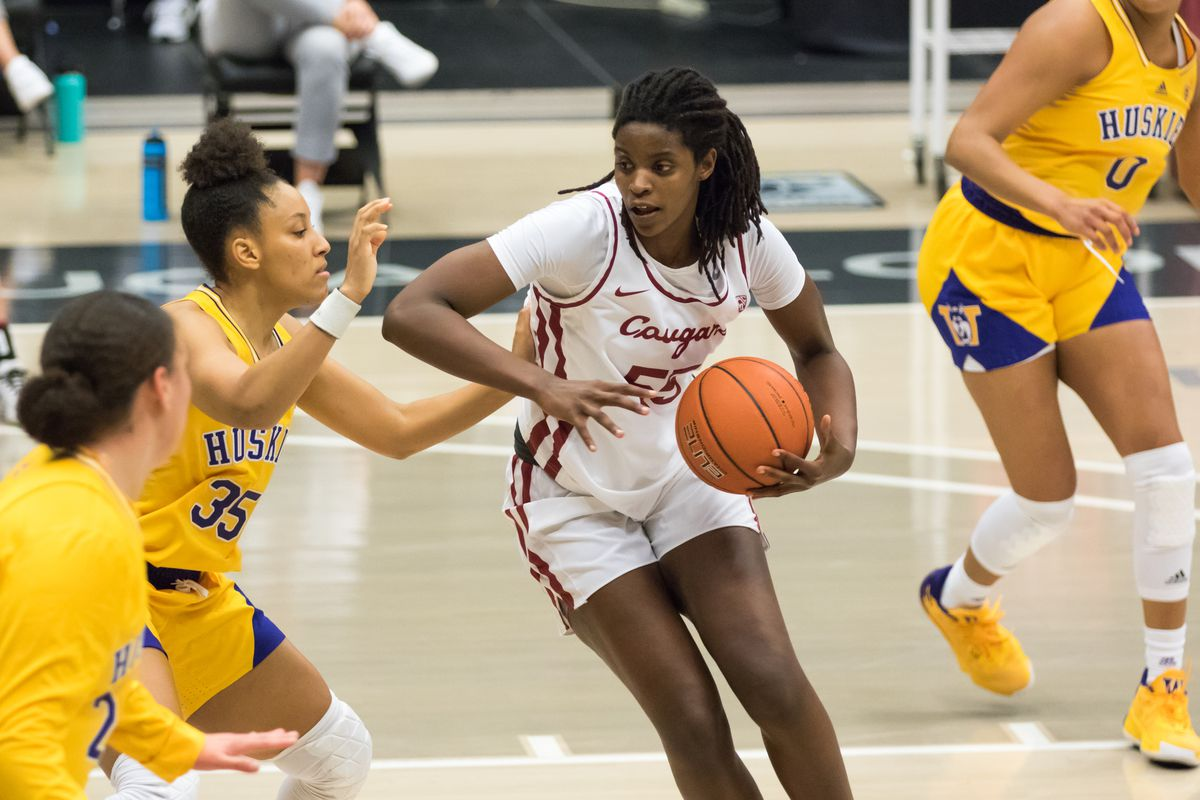 PULLMAN, WA - FEBRUARY 28: Washington State center Bella Murekatete (55) gets physical under the hoop during the first half of a Boeing Apple Cup Series matchup between the Washington Huskies and the Washington State Cougars on February 28, 2021, at Beasley Coliseum in Pullman, WA.