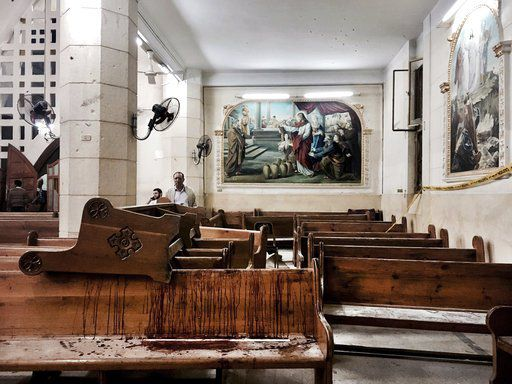 Blood stains pews inside the St. George Church after a suicide bombing, in the Nile Delta town of Tanta, Egypt on Sunday. Bombs exploded at two Coptic churches in the northern Egyptian cities of Tanta and Alexandria as worshippers were celebrating Palm Su