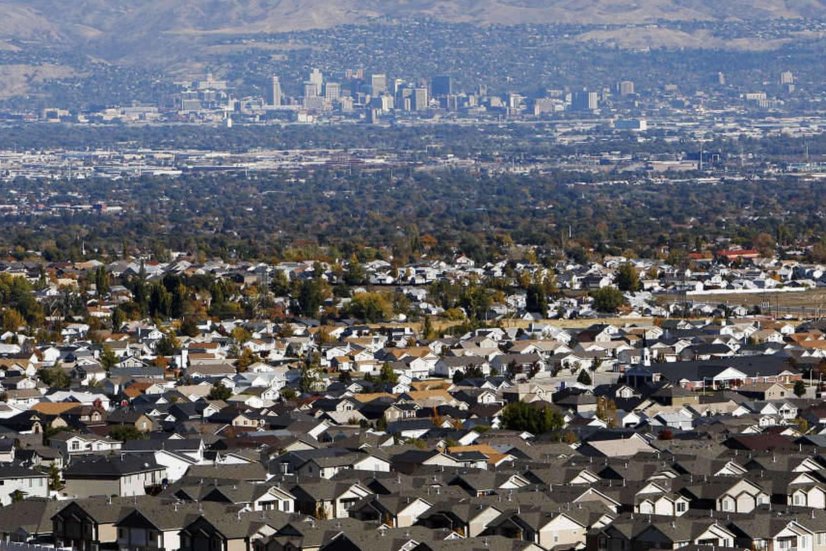Housing in the southwest area of Salt Lake County shows in the foreground with the Salt Lake City skyline in the background, Wednesday, Nov. 2, 2011.