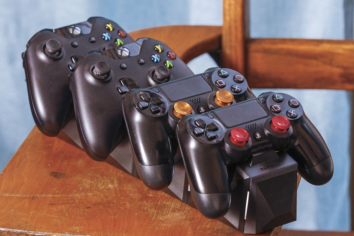 Playstation And Xbox Controllers Together In Perfect