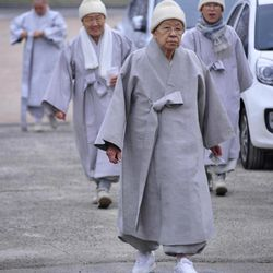 South Korean Buddhist nuns arrive to cast their votes for the parliamentary election at a polling station in Ulsan, south of Seoul, South Korea, Wednesday, April 11, 2012.