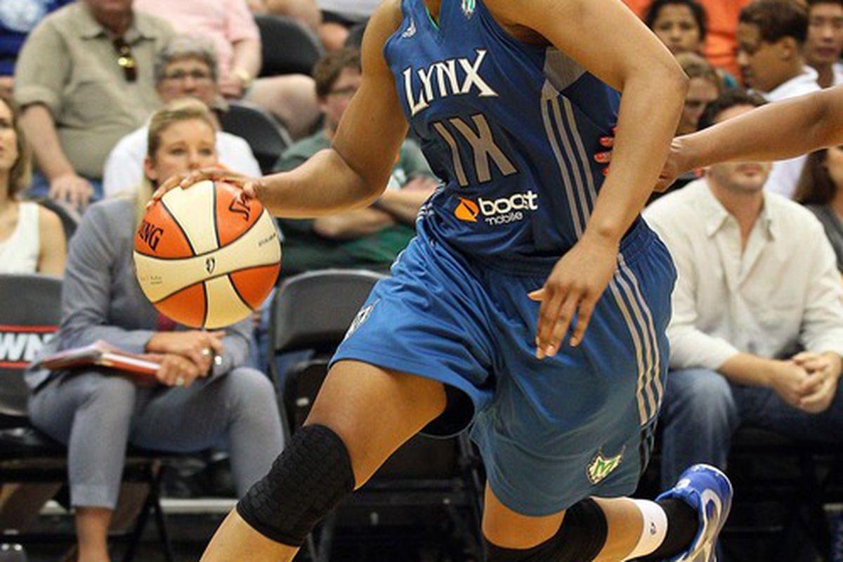 June 23, 2012; Minneapolis, MN, USA: Minnesota Lynx forward Maya Moore (23) drives to the basket against the Chicago Sky at Target Center. The Lynx won 79-67. Mandatory Credit: Jesse Johnson-US PRESSWIRE