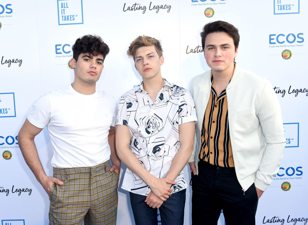 Singers Emery Kelly (from left), Ricky Garcia and Liam Attridge of Forever in Your Mind attend the All It Takes Lasting Legacy event at the headquarters of Earth Friendly Products in 2018.