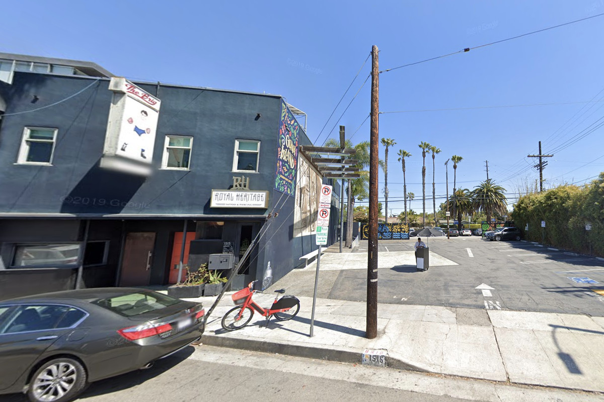 A street view shot of a parking lot next to a bar in sunny Venice, CA.