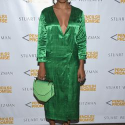 Solange Knowles pairs her yellow sandals with a very green, very shiny dress by Cistanthe.