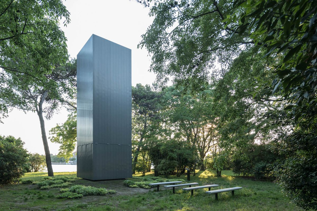 Rectangular metal chapel with benches