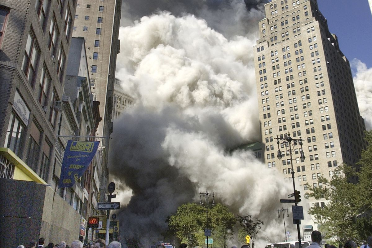 People flee the falling South Tower of the World Trade Center on Tuesday, Sept. 11, 2001. That morning, having worked an overnight shift for The Associated Press sports desk, Howie Rumberg came up out of a subway and found himself in the midst of chaos.