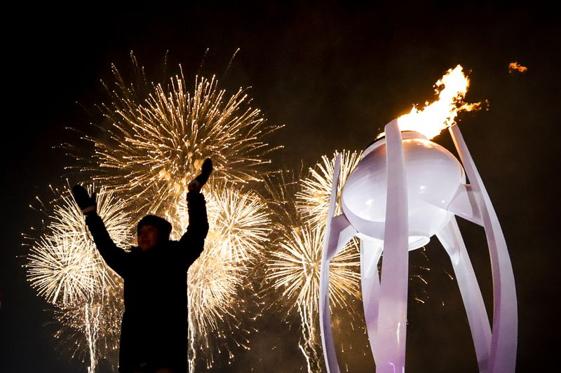 Fireworks erupt as the cauldron is lit with the Olympic flame during the opening ceremony of the Pyeongchang 2018 Winter Olympic Games at the Pyeongchang Stadium on February 9, 2018.