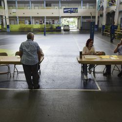 Puerto Rican citizens register before they can exercise their vote during the fifth referendum in San Juan, Puerto Rico, Sunday, June 11, 2017. Puerto Ricans are getting the chance to tell U.S. Congress on Sunday which political status they believe best benefits the U.S. territory as it remains mired in a deep economic crisis that has triggered an exodus of islanders to the U.S mainland. Congress ultimately has to approve the outcome of Sunday's referendum that offers voters three choices: statehood, free association/independence or current territorial status.
