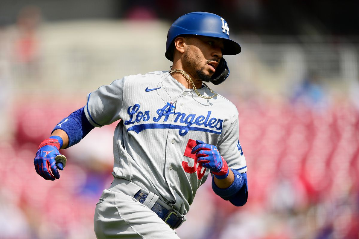 Mookie Betts #50 of the Los Angeles Dodgers runs to first base after hitting a single during their game against the Cincinnati Reds at Great American Ball Park on September 19, 2021 in Cincinnati, Ohio.