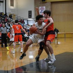 Richards' Trevon Jones (23) muscles his way past Brother Rice's Anthony Arquilla (23), Tuesday 02-19-19. Worsom Robinson/For the Sun-Times.