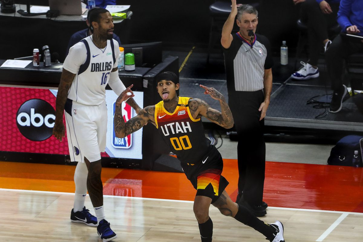 Utah Jazz guard Jordan Clarkson (00) sticks his tongue out and holds up three fingers after nailing a 3-pointer during the Dallas Mavericks and Utah Jazz NBA game at Vivint Smart Home Arena in Salt Lake City on Friday, Jan. 29, 2021.