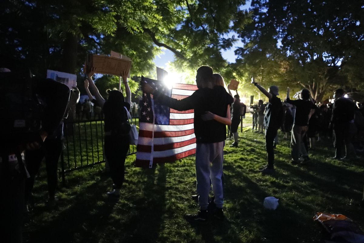 Demonstrators gather to protest the death of George Floyd, Sunday, May 31, 2020, near the White House in Washington. Floyd died after being restrained by Minneapolis police officers (AP Photo/Alex Brandon)