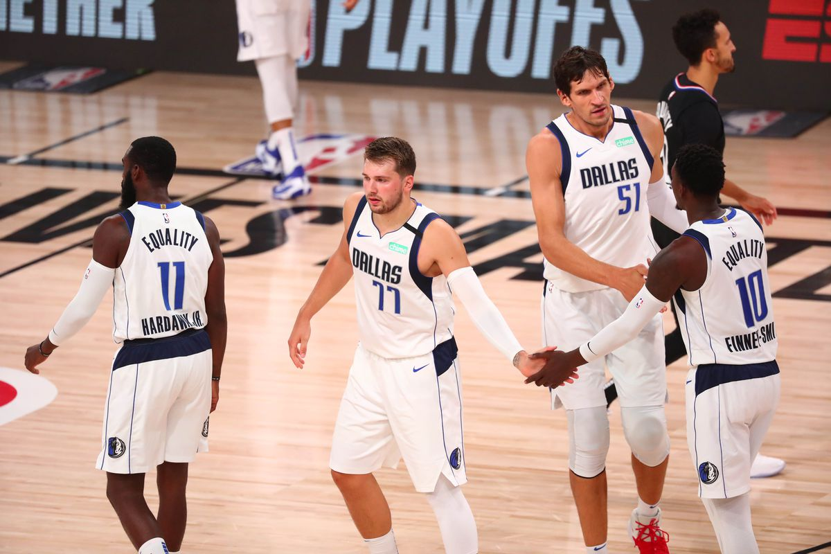 Dallas Mavericks guard Luka Doncic celebrates with teammates during the first quarter in game six of the first round of the 2020 NBA Playoffs against the LA Clippers at AdventHealth Arena.
