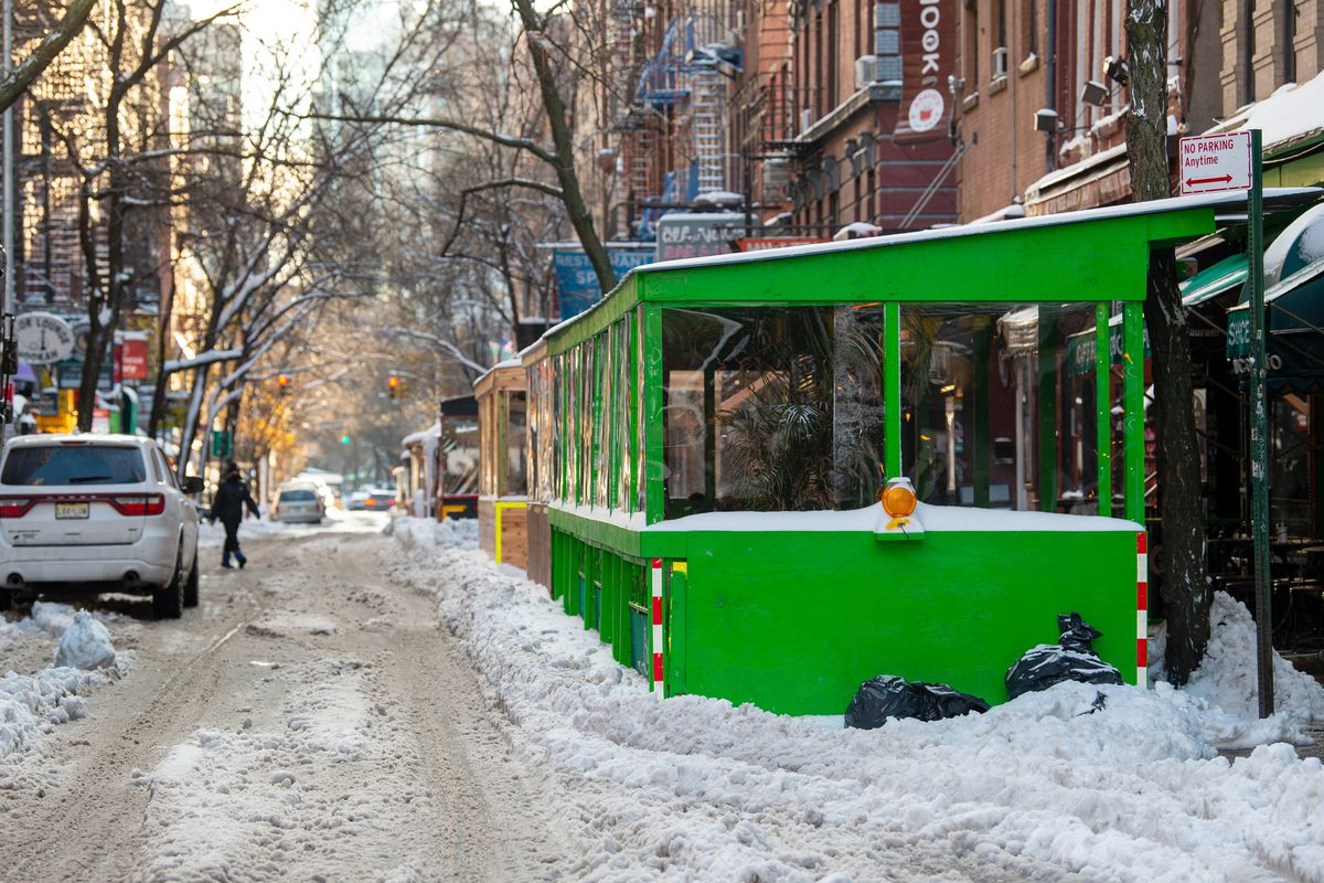 Caffe Reggio's outdoor dining area is covered in snow on December 17, 2020 in New York City.