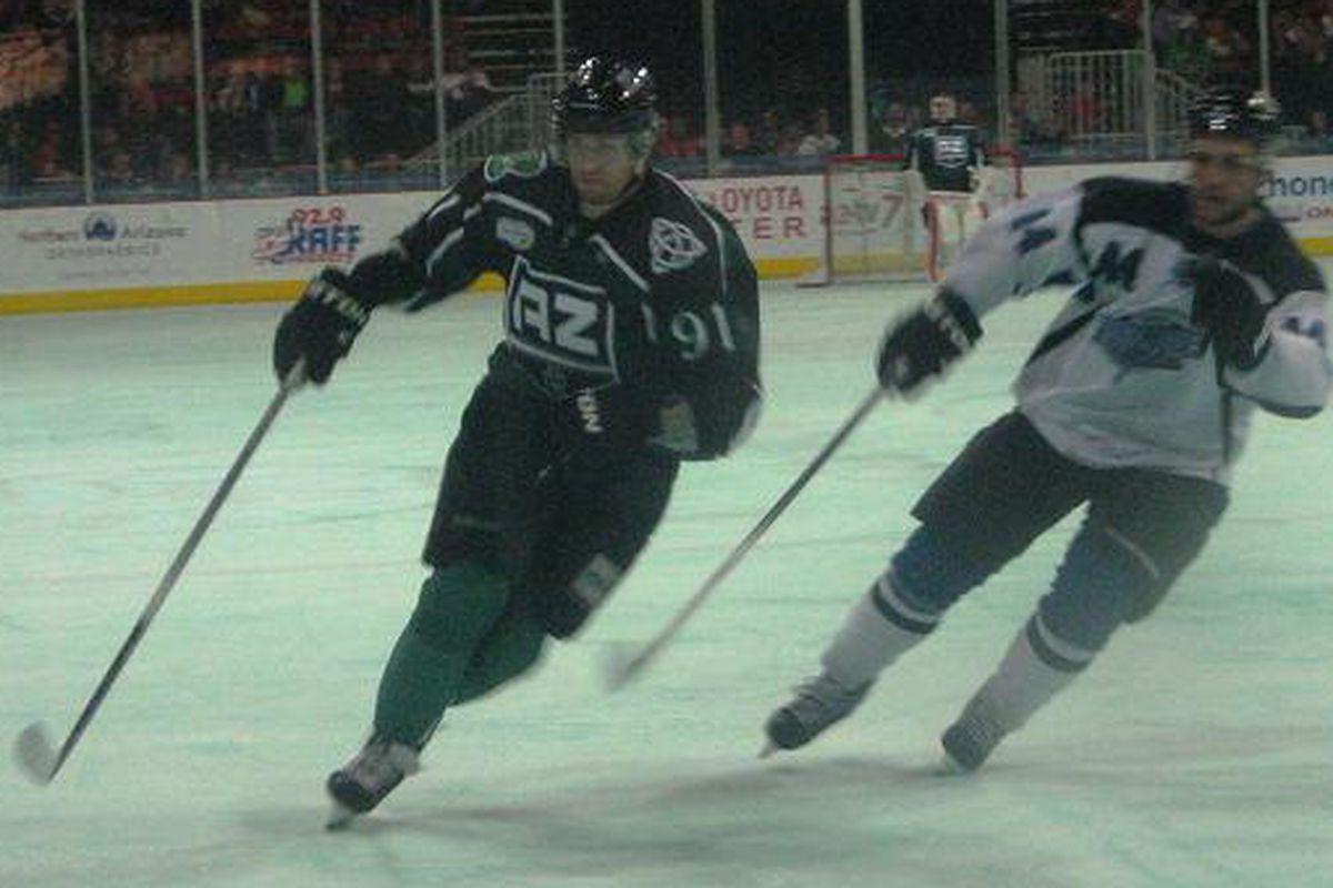 Derek LeBlanc wearing the St.Patrick's specialty jerseys on the green ice
