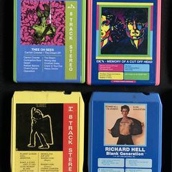 Top: Reconditioned 8-track cartridges with new labels. Botton: Original labeling of other cartridges