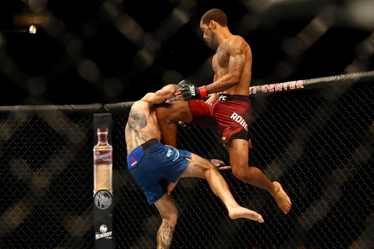 Roosevelt Roberts (red gloves) fights Vinc Pichel (blue gloves) during UFC Fight Night at Target Center.