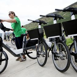 Park City Councilwoman Becca Gerber gets on an electric bike after attending a press conference launching the nation's first fully electric bike-share program in Park City on Wednesday, July 19, 2017.