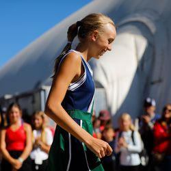 Green Canyon freshman Bailey Huebner smiles as she walks to receives a medal after coming first at the first singles final of the 4A girls singles tennis state tournament at Liberty Park Tennis Center in Salt Lake City on Saturday, Oct. 2, 2021.