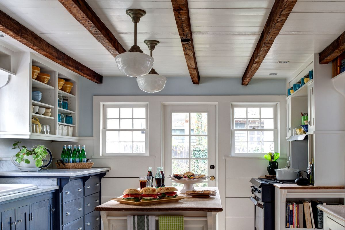 Kitchen with faux-wood beams