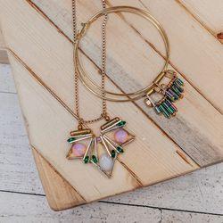 <b>Scho</b> necklace, $300; <b>Scho</b> earrings, $163