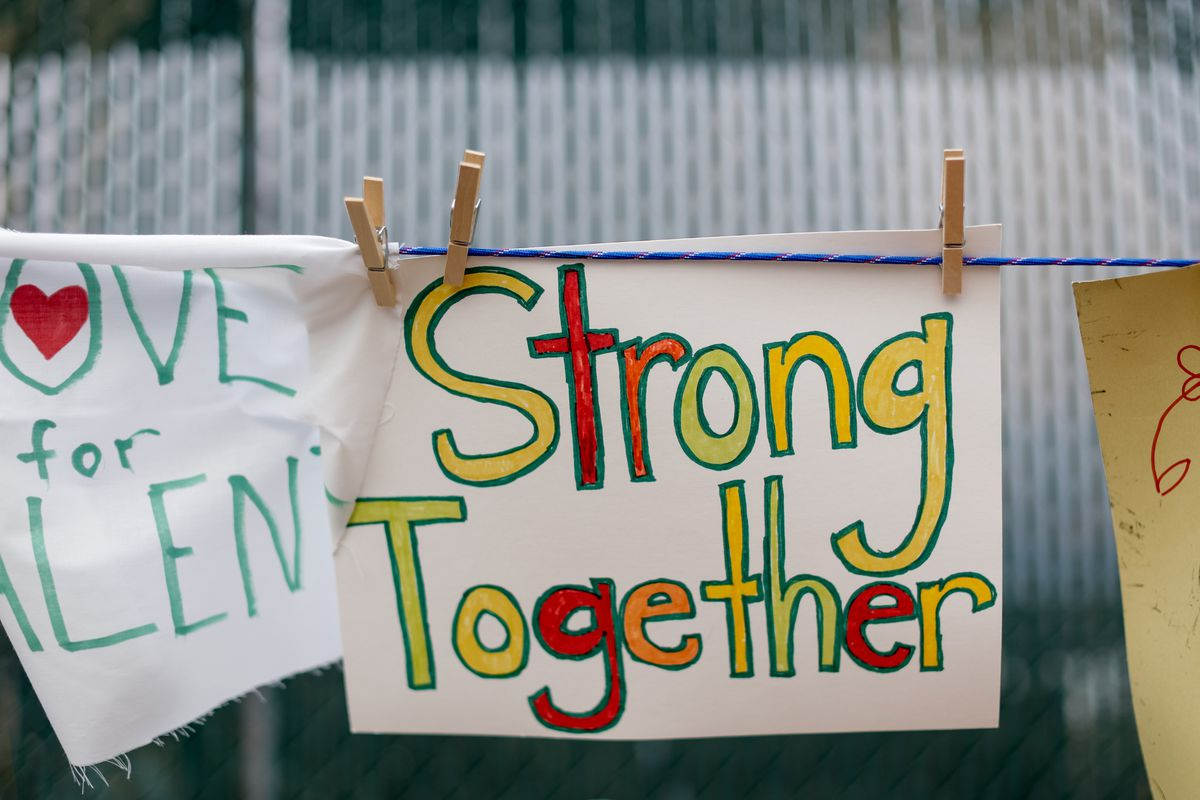 Signs made by community members are strung up on the side of the road in Talent, Ore., on Tuesday, Sept. 22, 2020.