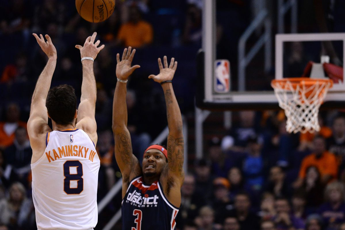 Phoenix Suns forward Frank Kaminsky shoots over Washington Wizards guard Bradley Beal during the second half at Talking Stick Resort Arena.