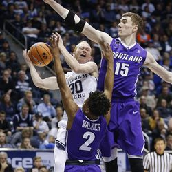 Brigham Young Cougars guard TJ Haws (30) drive son Portland Pilots center Philipp Hartwich (15) in Provo on Thursday, Dec. 28, 2017. BYU won 69-45.