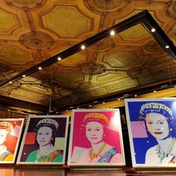 """Four Andy Warhol portraits of Queen Elizabeth II are seen in Windsor Castle, Windsor, England, Monday Sept. 24, 2012, and will form part of the """"Portraits of a Monarch"""" exhibit starting in November at Windsor Castle until June 2013. The colorful screenprints are based on a formal photograph of the queen wearing a tiara and necklace that was used during her Silver Jubilee celebrations in 1977."""