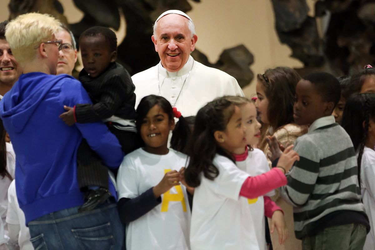 Pope Francis with children and their families in December 2013 at the Pediatric Dispensary of Santa Marta