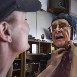 Skydive Ogden owner Suzanne Wallace helps fit Wendell Ashcroft in a cap at Skydive Ogden in Ogden on Saturday, Aug. 5, 2017.