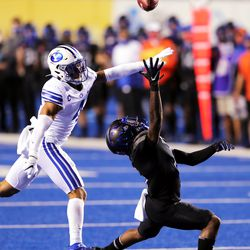 BYU defensive back Troy Warner (4) defends Boise State wide receiver CT Thomas (6) down field as BYU and Boise State play a college football game at Albertsons Stadium in Boise on Friday, Nov. 6, 2020.