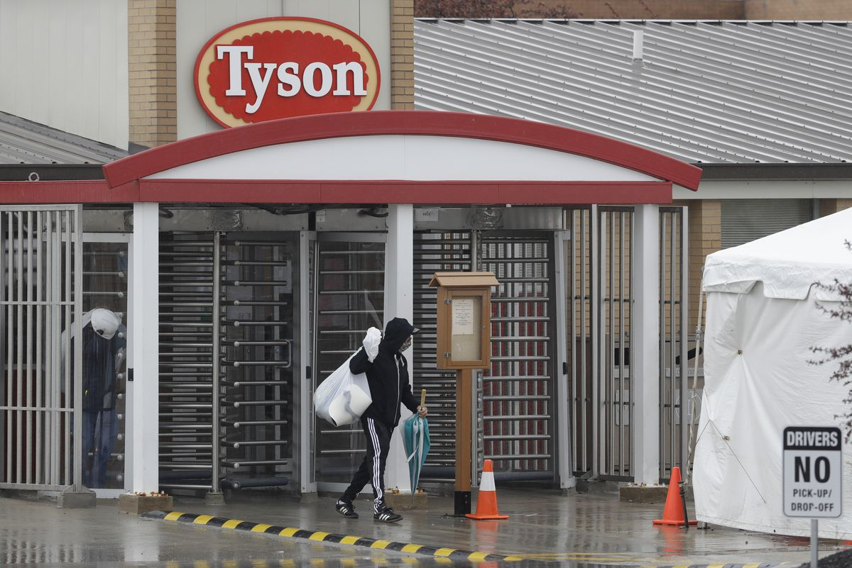 A Tyson Fresh Meats plant employee leaves the plant, Thursday, April 23, 2020, in Logansport, Ind.