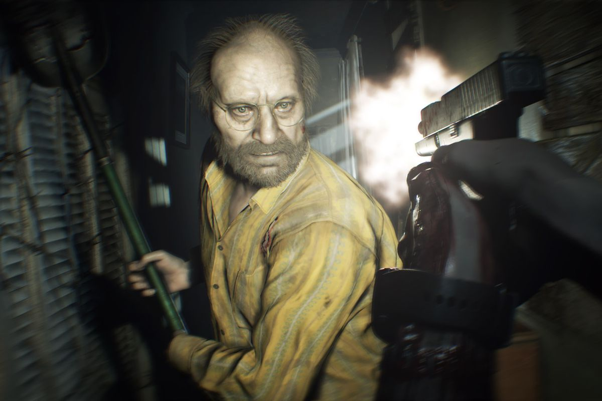 In this Resident Evil 7 screenshot, the antagonist Jack is seen approaching the main character with a shovel raised, ready to attack. The main characters bloodied hands can be seen, aiming a pistol and shooting it at the crazed attacker.