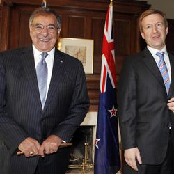 U.S. Defense Secretary Leon Panetta, left, smiles next to New Zealand's Defense Minister Jonathan Coleman at the Government House in Auckland, New Zealand Friday, Sept. 21, 2012. Panetta become the first Pentagon chief to visit the South Pacific nation in 30 years as the U.S. tries to rebuild military ties that were fractured when New Zealand banned nuclear warships from its shores.